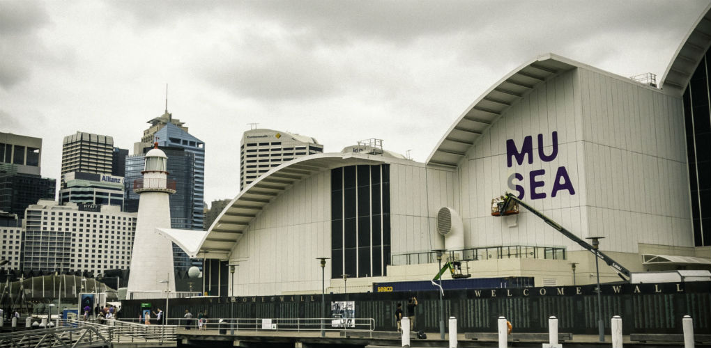 Installing the new MUSEAUM logo, viewed from Wharf 7. Photo: Kate Pentecost