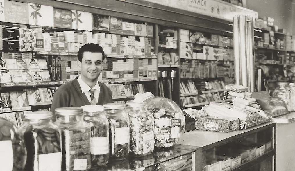 Emanuel Comino behind the counter of his milk bar in Guildford, Sydney, 1960s.