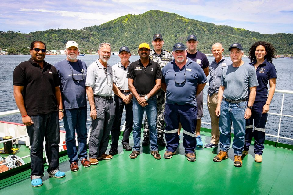 Members of the Find AE1 expedition team with representatives from Fugro Survey in Simpson Harbour, Rabaul, Papua New Guinea. From left: Tanesh Thanapalan (Fugro Survey), Paul Hundley (Silentworld Foundation), Rear Admiral Peter Briggs AO CSC RAN(Rtd) (Find AE1 Ltd), Captain Roger Turner RN Rtd (Find AE1 Ltd), Chandran Karapiah (Fugro Survey), Lieutenant James McPherson RANR (Royal Australian Navy), Gus Mellon (Find AE1 Ltd), Andrej Masloboev (Fugro Survey), Magnus Windle (Fugro Survey), Nigel Erskine (Australian National Maritime Museum), Irini Malliaros (Silentworld Foundation). Image: ANMM/Find AE1 Ltd.