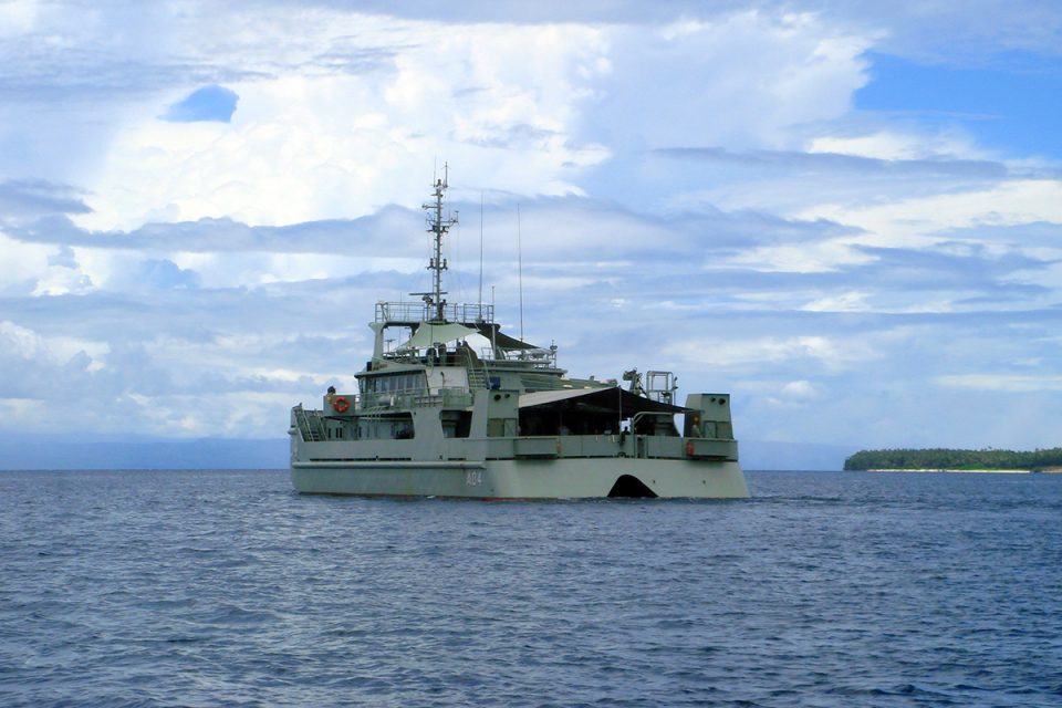 HMAS Benalla conducts a multi-beam sonar survey for AE1 off Mioko Island, February 2007. Photographer: Gus Mellon/Find AE1 Ltd.