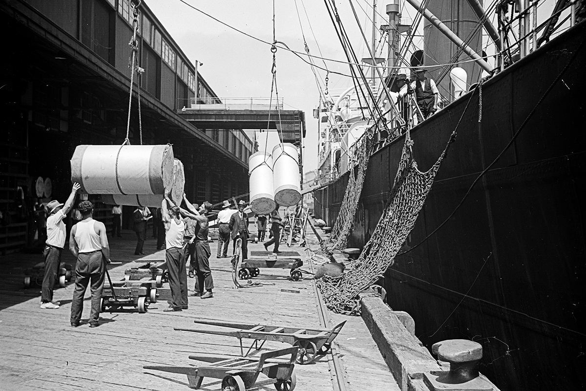 Pre-containerisation, loading cargo on vessels was a physically demanding and long process. Samuel J Hood Studio, circa 1933. ANMM Collection 00035833.