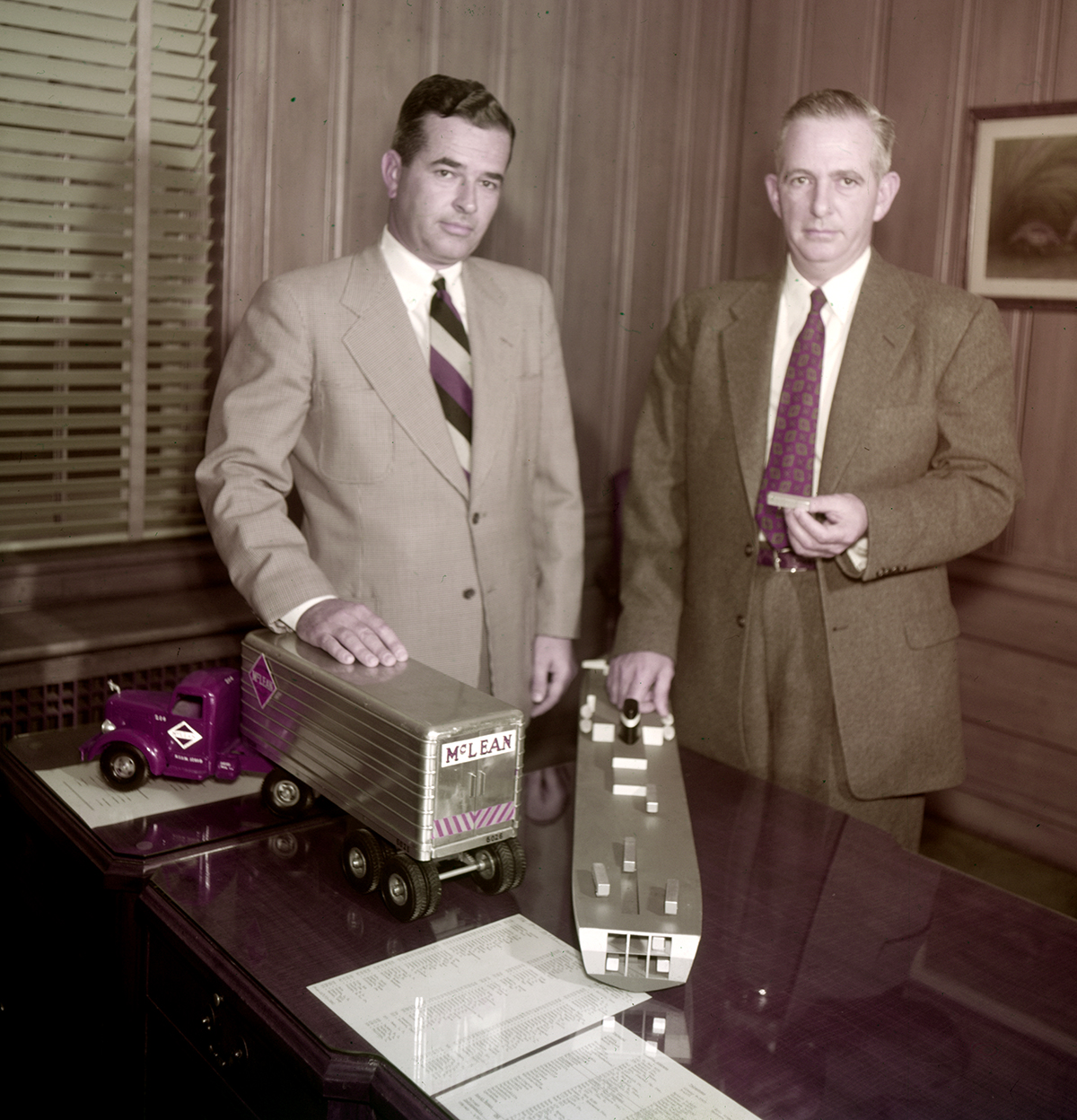 Jim and Malcom McLean demonstrate their shipping plans, Winston-Salem, North Carolina, photo Frank Jones, 1954. Reproduced courtesy of Forsyth County Public Library Photograph Collection, North Carolina, USA.