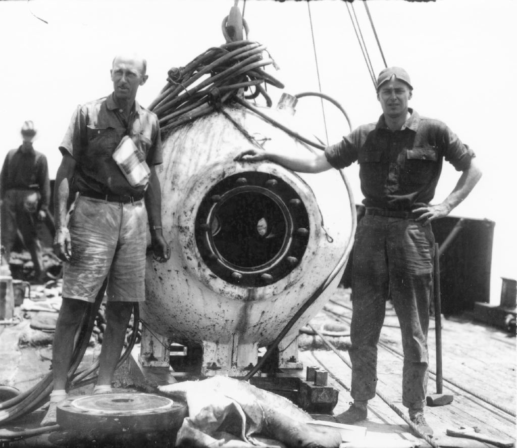 "Dr William Beebe (left) with Otis Barton. Together, they championed and built a spherical diving submersible which Beebe described as a 'bathysphere', from the Greek 'bathus' meaning ""deep"" and 'sphaira' or ""sphere"". Image: Wildlife Conservation Society, New York."