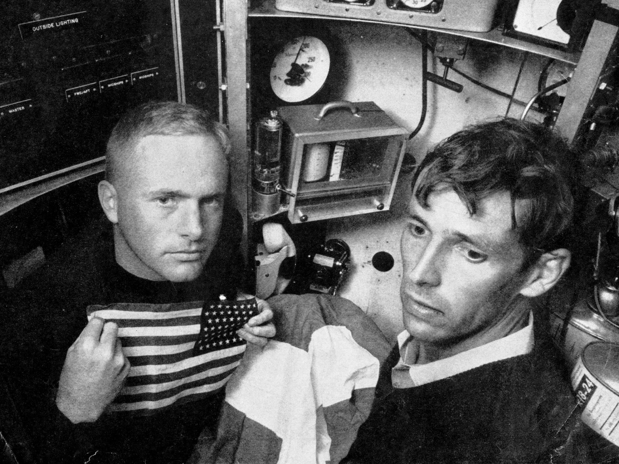 Lieutenant Don Walsh (left) and Jacques Piccard in the bathyscaphe.