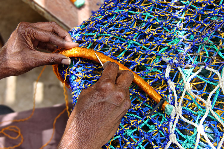 The sculptures are handmade with vibrantly coloured fishing nets. Image: Erub Arts.