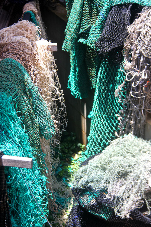 Rangers recover, clean and process the net before the artists reuse the fibres to create ghost net art. Image: Erub Arts.
