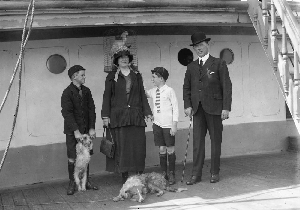 Portrait of the Captain's family. Captain McColm, his wife Adelaide and two young sons Malcolm and Duncan. With them are two pet dogs and a caged cockatoo. Taken on the deck of the three masted ship MOUNT STEWART.
