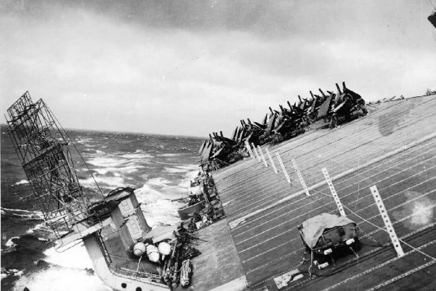 The flight deck of USS <em>Cowpens</em>during Typhoon Cobra, 18 December 1944. Image: USA National Archives.