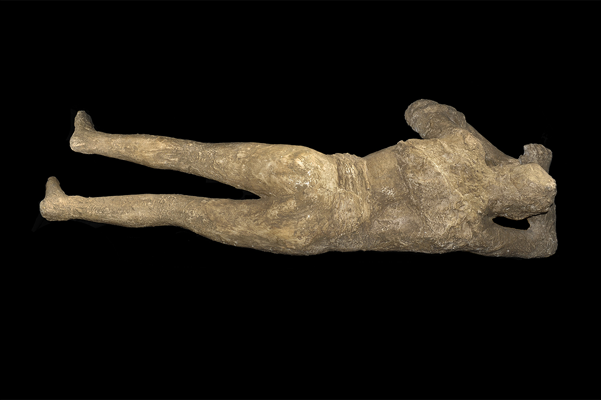 Body cast of one of the victims from Pompeii. This is a copy of a cast made in 1875. It shows the victim with her clothes forced up around her waist from the power of the pyroclastic surge. © Ministero dei beni e delle attività culturali e del turismo – Soprintendenza Speciale Pompei