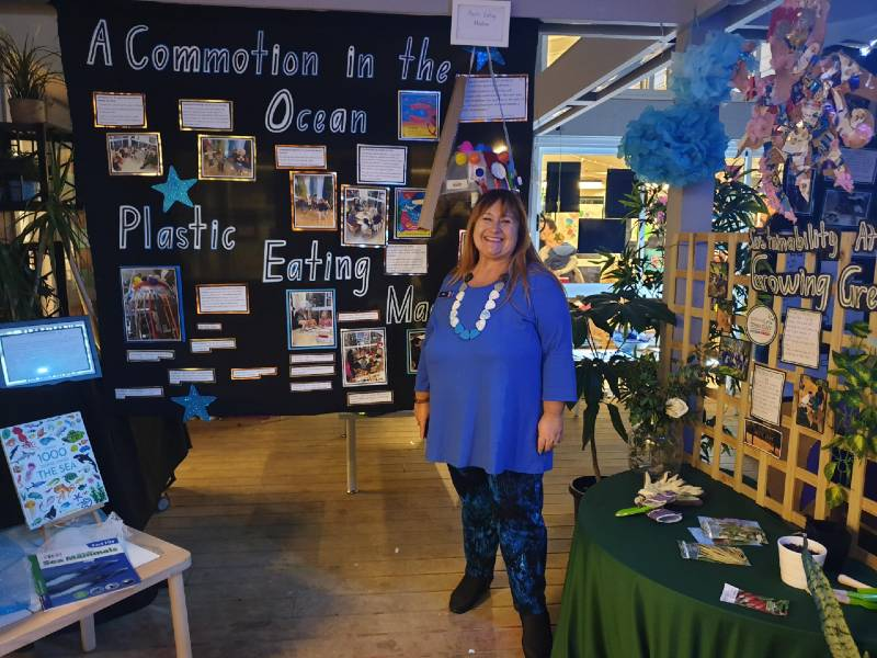 Senior Education Officer Rita Kusevskis-Hayes in front of the Commotion in the Ocean display