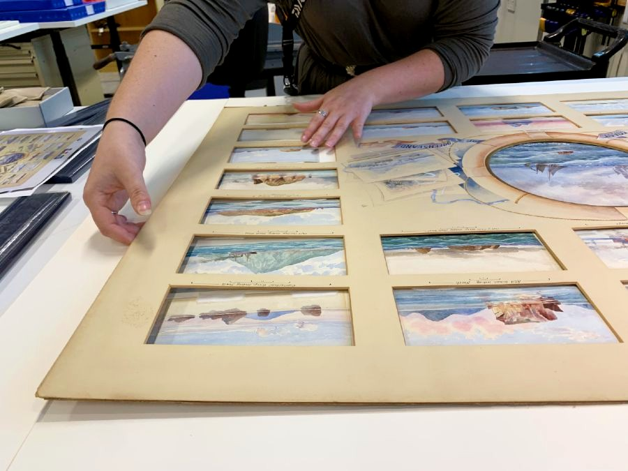 Carefully adjusting each individual watercolour so it sits under its window exactly as it did before
