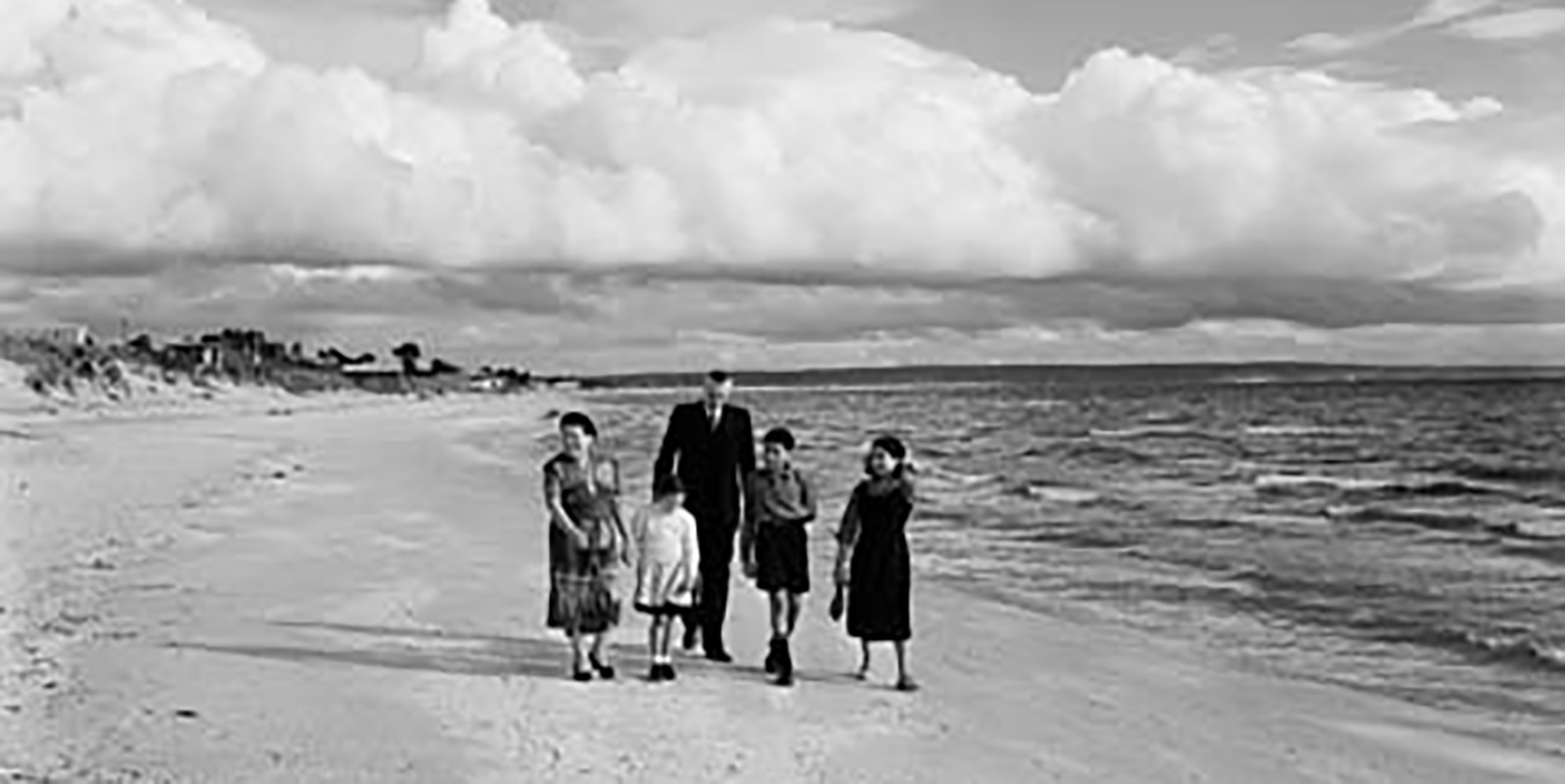 The O'Keefe family at Bonbeach, Victoria, 1956. Left to right: Annie O'Keefe, Geraldine, John O'Keefe, Peter and Mary. Photographer Neil Murray. Reproduced courtesy National Archives of Australia: A1501, A429/5.
