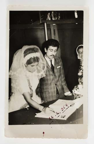 Şükran and Halit Adasal signing their marriage documents, with Şükran's mother Sultan Salman at far right, Adana, Turkey, 1966. Reproduced courtesy Hale Adasal.