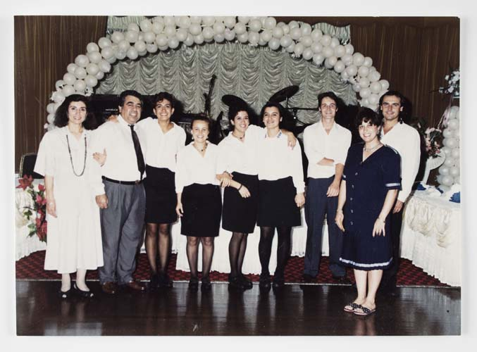 The Adasal family with staff at their Bosphorus Function Centre in Auburn, 1990s. Şükran, Halit and Hale are at far left, with Funda in the centre. Reproduced courtesy Hale Adasal.