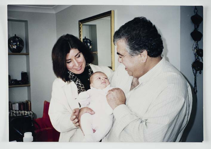 Şükran and Halit Adasal with their newborn granddaughter Yasemin, 2000. Reproduced courtesy Hale Adasal.