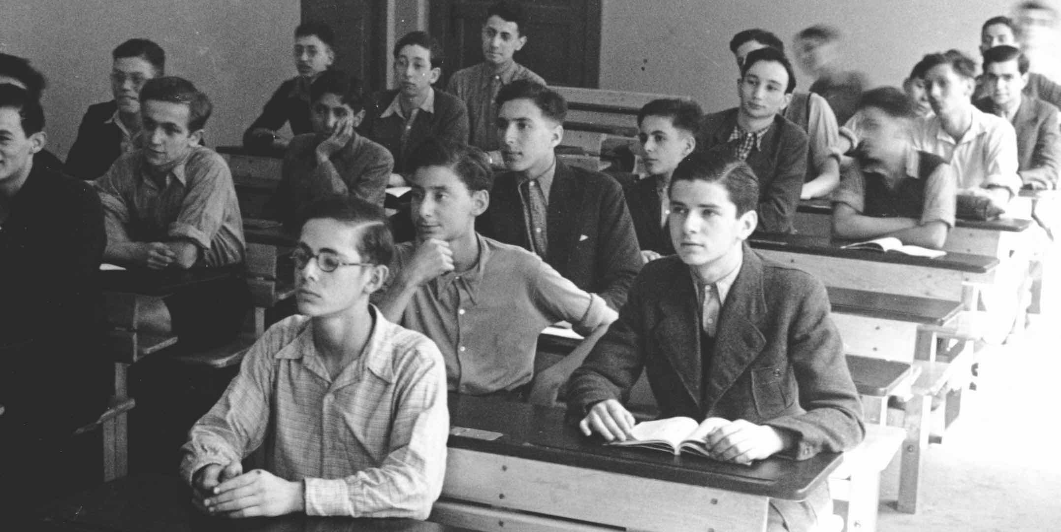 Henry Lippmann (centre, with hand on chin) during a lesson at the Jewish ORT school in Berlin, Germany, c 1939. ANMM Collection ANMS0219[007], gift from Henry Lippmann