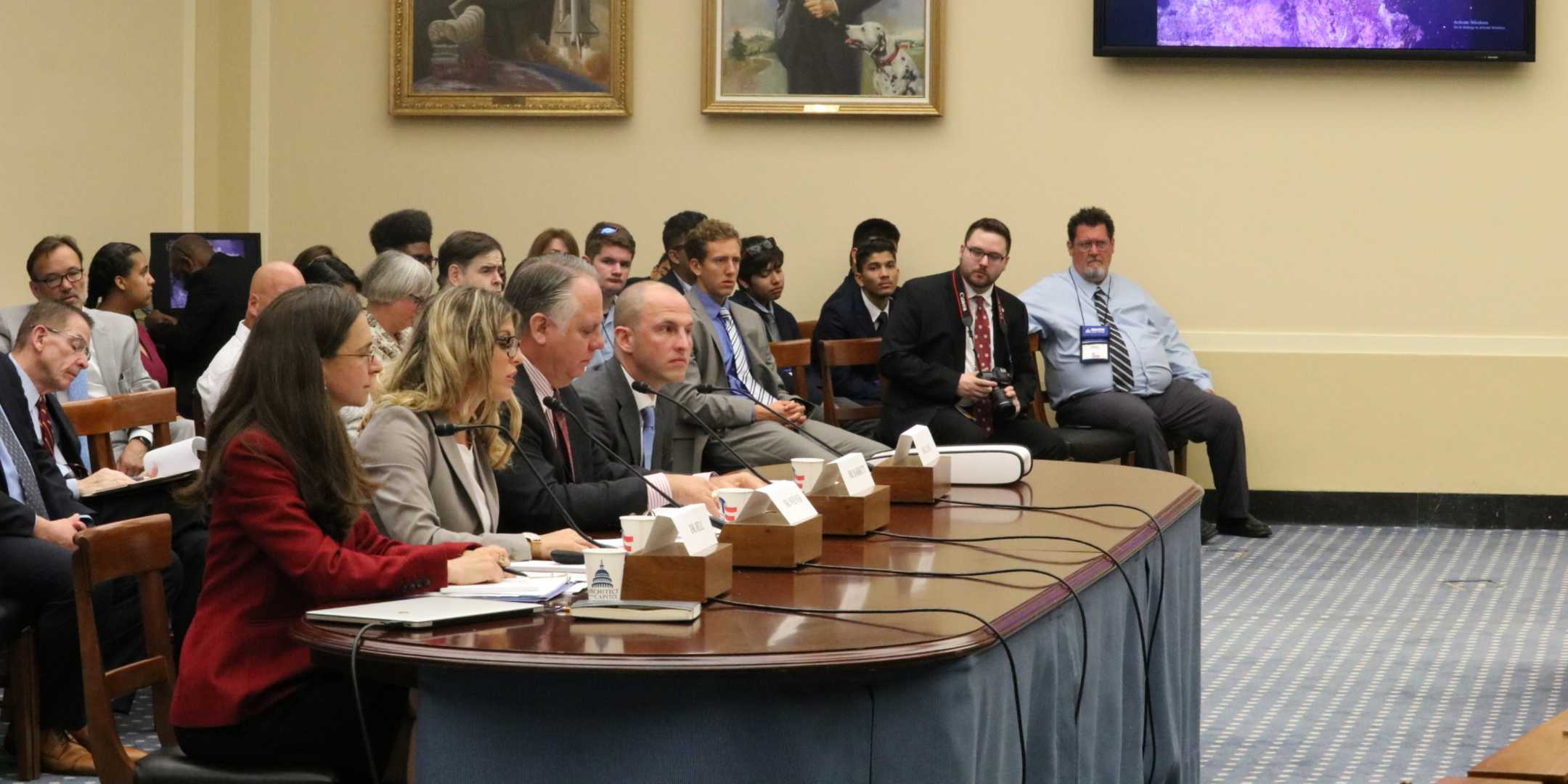 Dr Carlie Wiener (second from left) speaking at the House Committee Hearing. Image courtesy Catherine Anderson