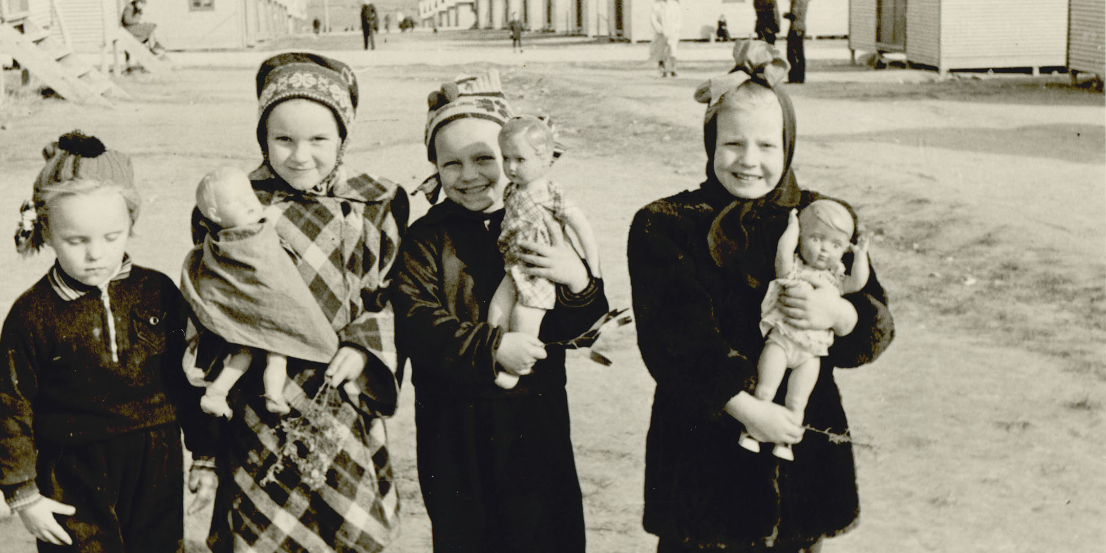 Maie Talmet (second from left) at Woodside Hostel with the doll her father gave her on arrival in Adelaide, 1949. Reproduced courtesy Maie Barrow.