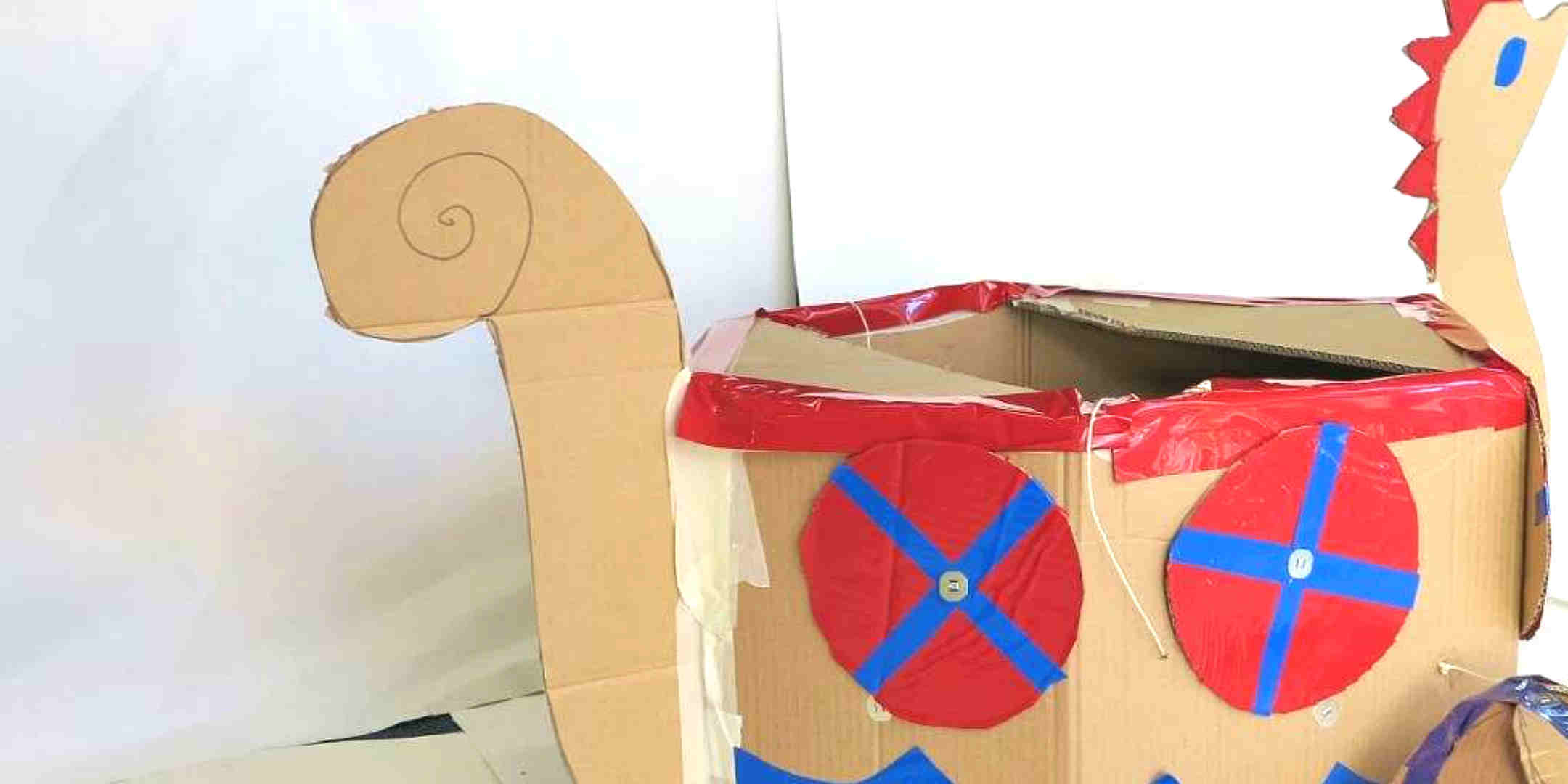 Re-use a cardboard boxes to make a fearsome viking boat, helmet and sword!