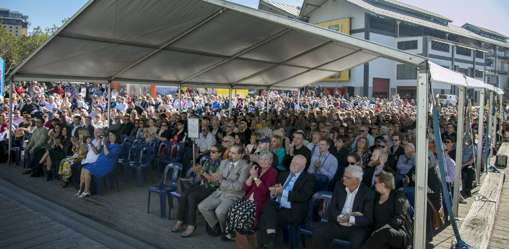 Welcome Wall unveiling ceremony, 7 May 2018. Guests in the crowd seated during the event.