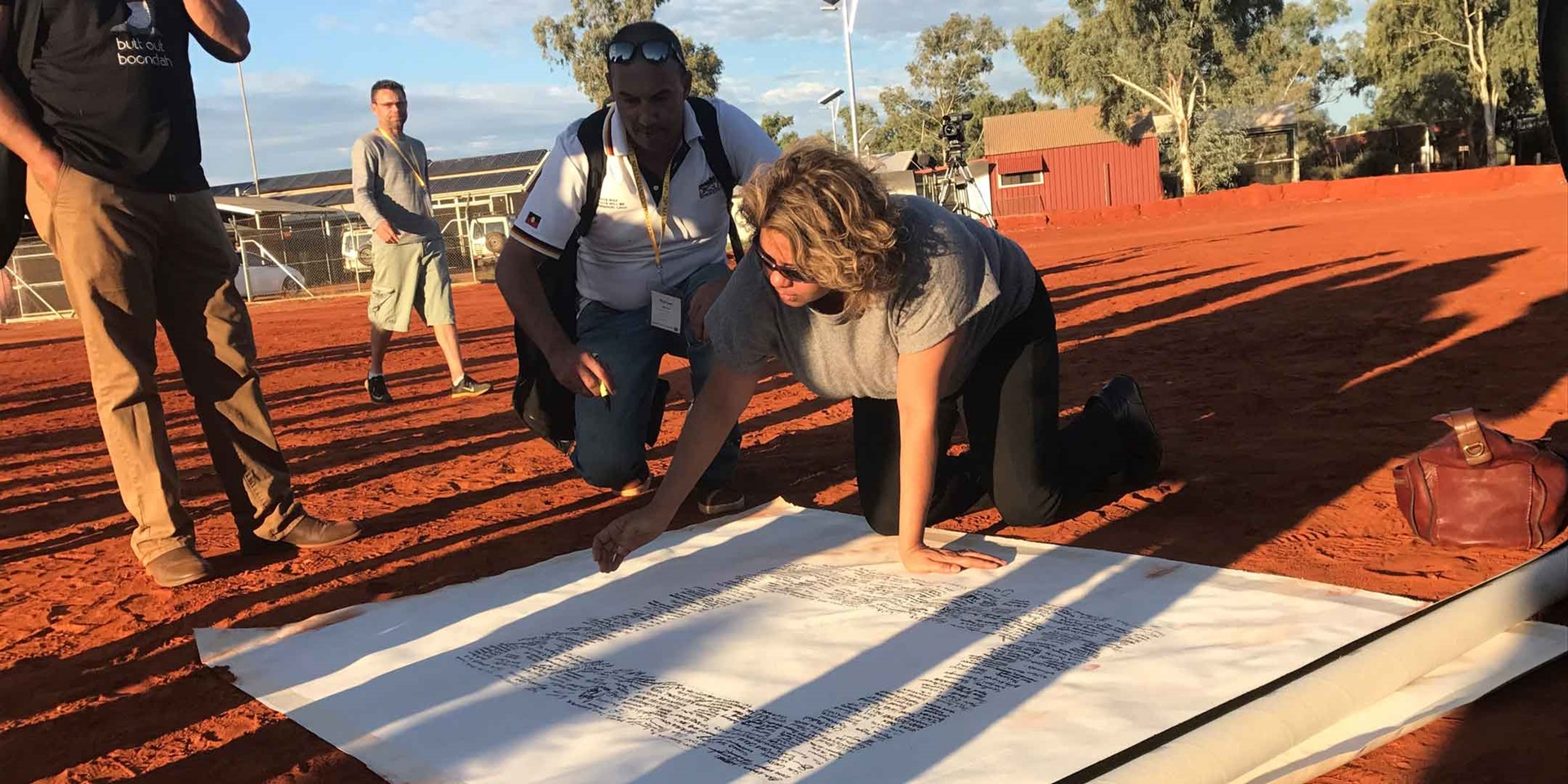Denise Bowden, CEO of Yothu Yindi, signing the Uluru Statement from the Heart, in Central Australia, 29 May 2017, Australian Human Rights Commission.