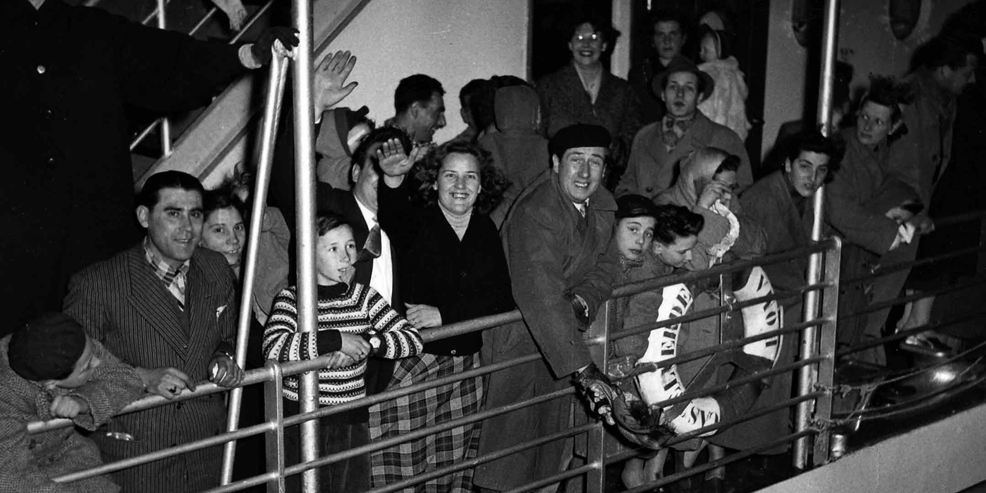 Group of migrants on the deck of MV Castel Verde, Italy, 1950–1957. ANMM Collection Gift from Barbara Alysen. Reproduced courtesy International Organisation for Migration. ANMM Collection ANMS0214[024]