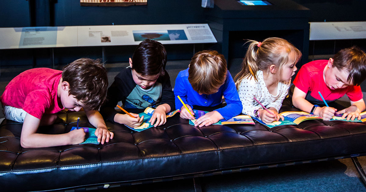 A group of children participating in an activity trail within the museum