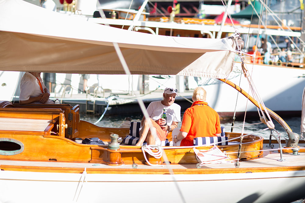 Boat owners relaxing at the Classic & Wooden Boat Festival.