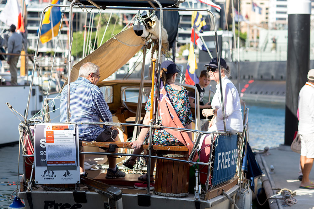Boat owners relaxing and having a chat at the Classic & Wooden Boat Festival.