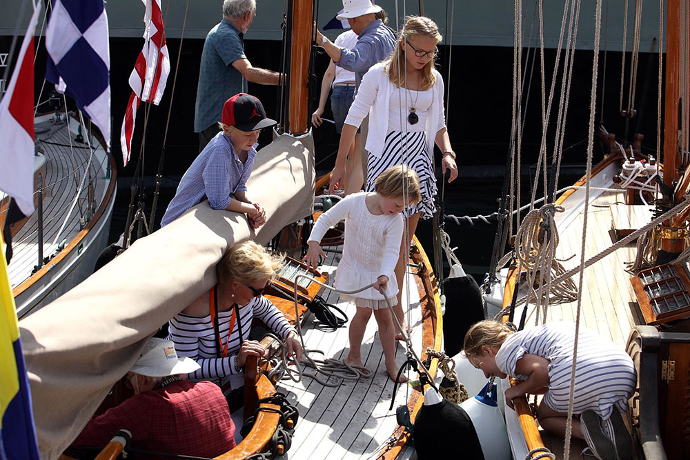 A family investigating the boats on show at the Classic and Wooden Boat Festival