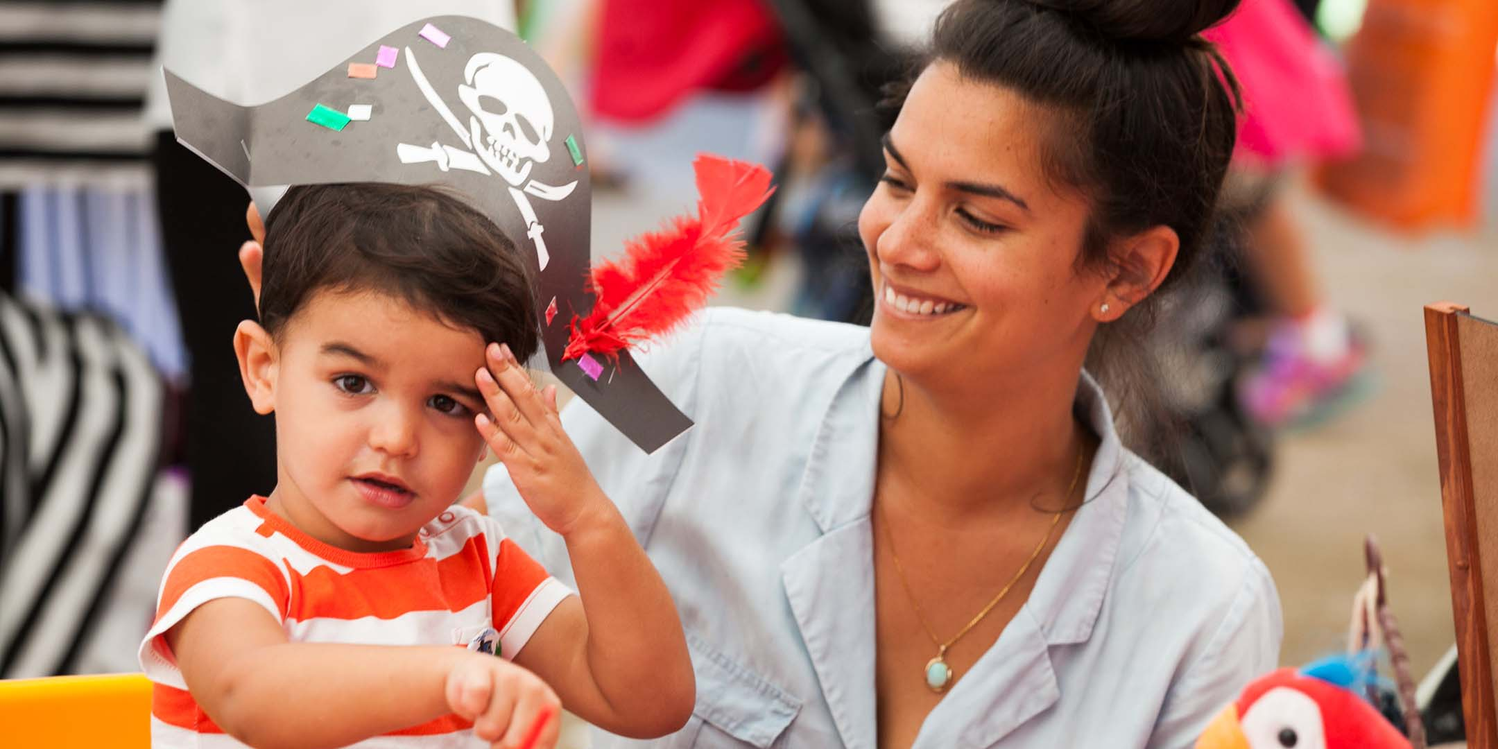 A mother with her young son wearing his craft pirate hat