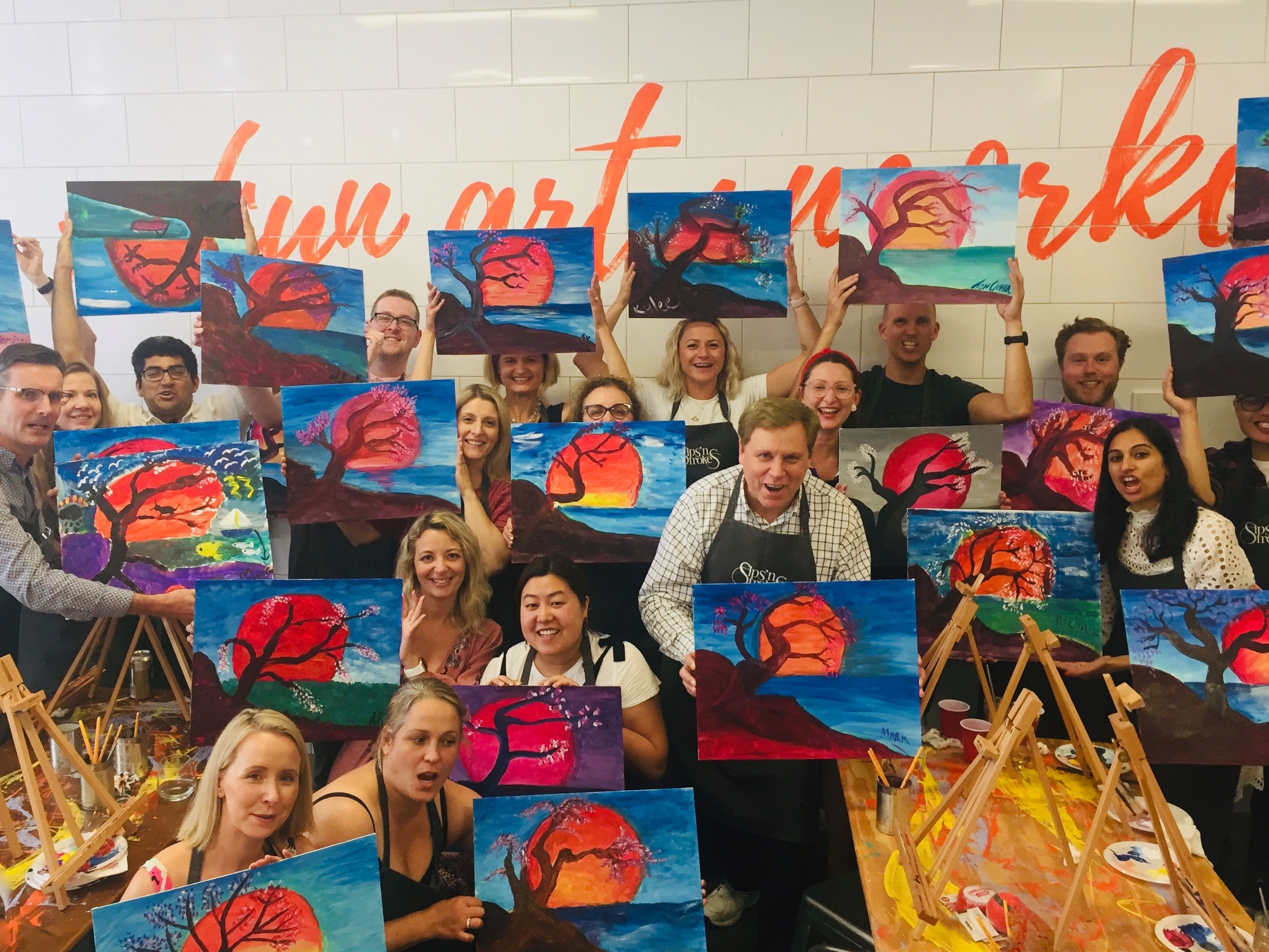 Group enjoying their finished Sip n Strokes art