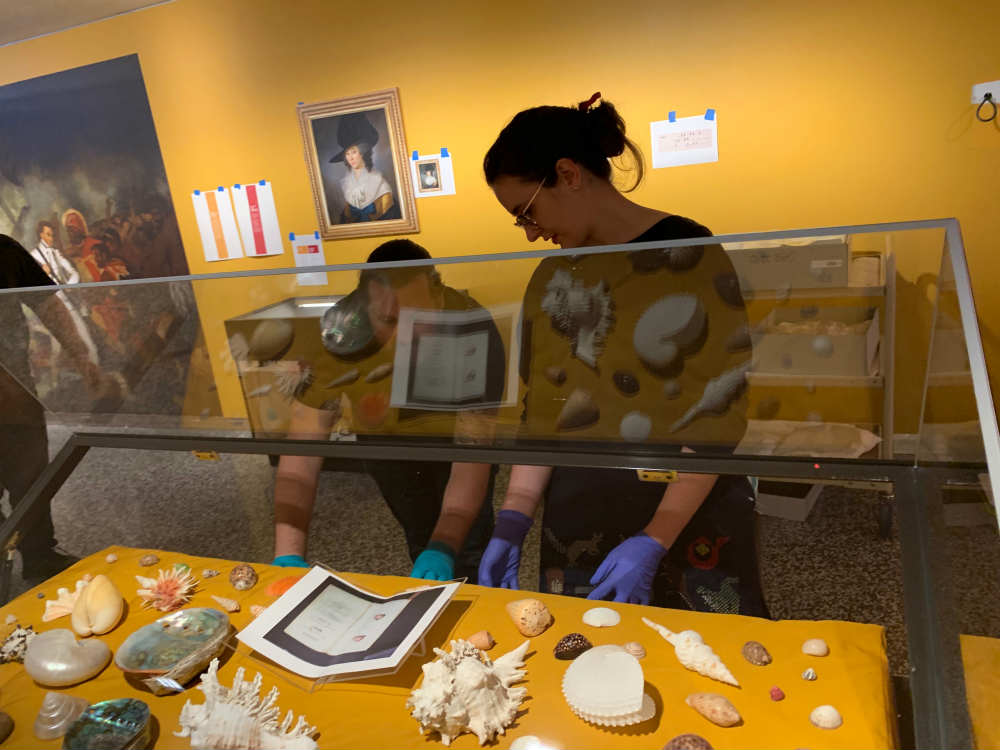 Conservator Jeff Fox and Registrar Nicole Dahlberg installing exhibition objects. Image: ANMM