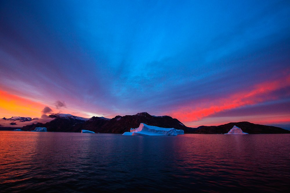 'Why then do we feel this strange attraction for these polar regions, a feeling so powerful and lasting, that when we return home we forget the mental and physical hardships and want nothing more than to return to them?' (Jean-Baptiste Charcot, Polar Explorer.) The sun sets at Kangertittivaq. Image Andreas Jaschek, Eskimo Bay, 2015.