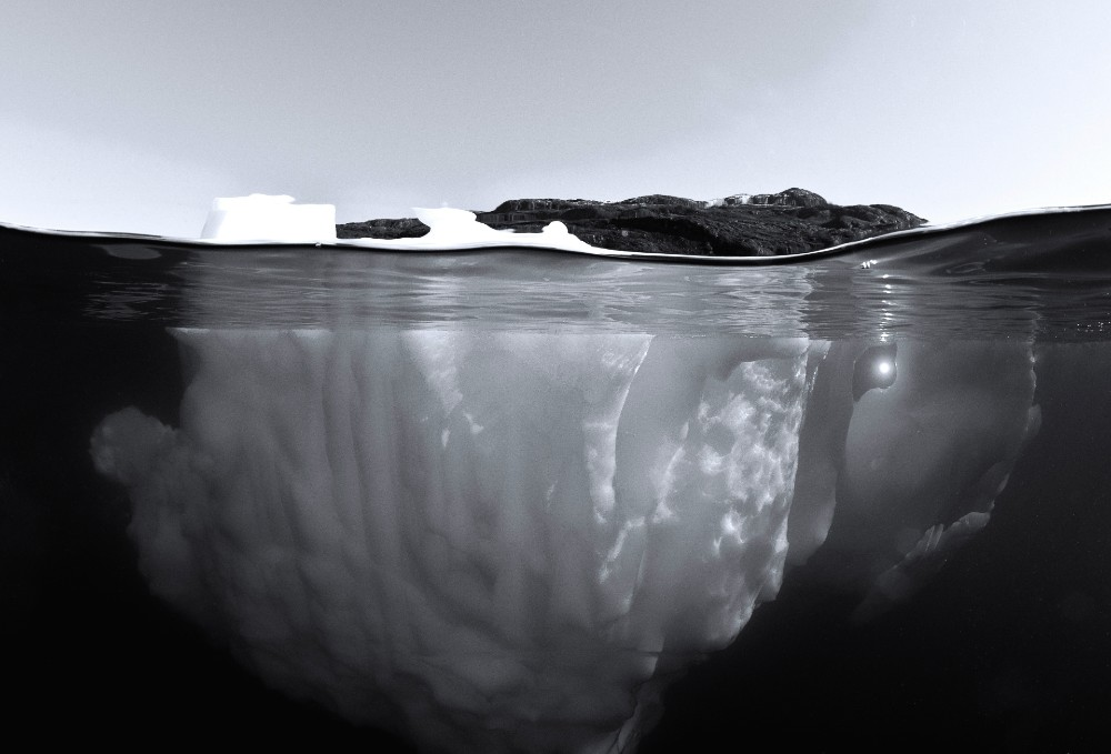 'If one image resonates with one person to inspire change, this expedition has won.' (Jennifer Hayes, Principal Photographer.) An iceberg from below the surface. Image Michael AW, Greenland, 2015.