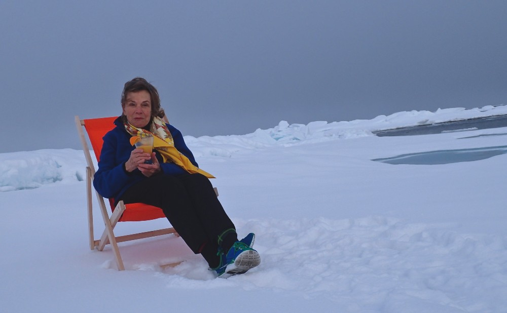 Dr Sylvia Earle poses with a cocktail to demonstrate the possible future of the warming Arctic. Image Michael Aw, Svalbard, 2015.