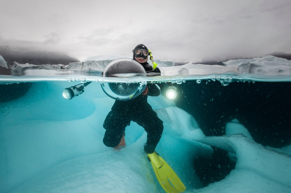 Expedition Director Michael Aw diving into Arctic waters. Image Jennifer Hayes, Svalbard, 2015.