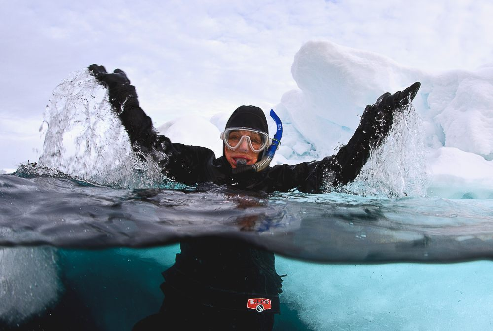 Dr Sylvia Earle celebrated her 80th birthday by snorkelling in the Arctic Ocean. Image Michael Aw, Svalbard, 2015.Dr Sylvia Earle celebrated her 80th birthday by snorkelling in the Arctic Ocean. Image Michael Aw, Svalbard, 2015.