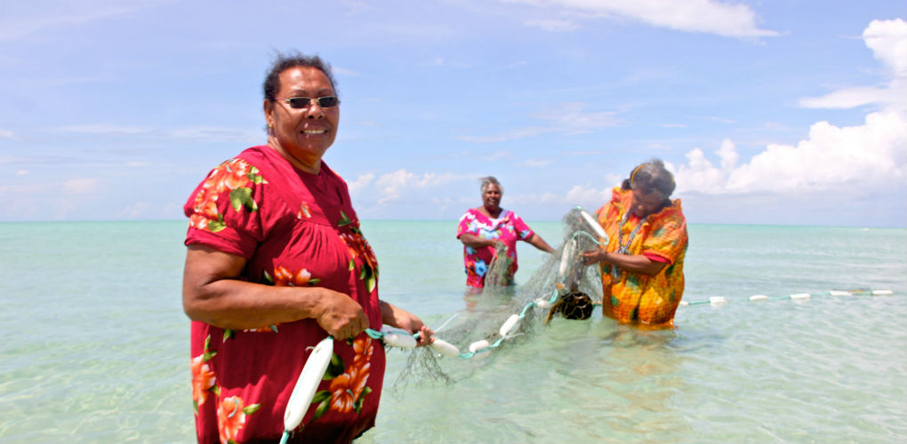 Artists with ghost net sculptures. Photo: Erub Arts, Darnley Island, Torres Strait