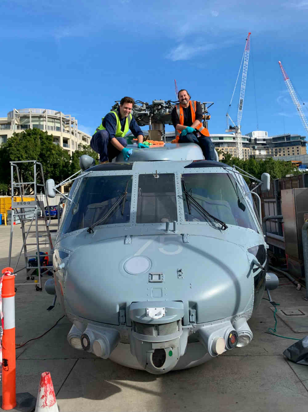 Conservators Nick Flood and Jeff Fox on top of the Seahawk checking external surfaces not visible from the ground