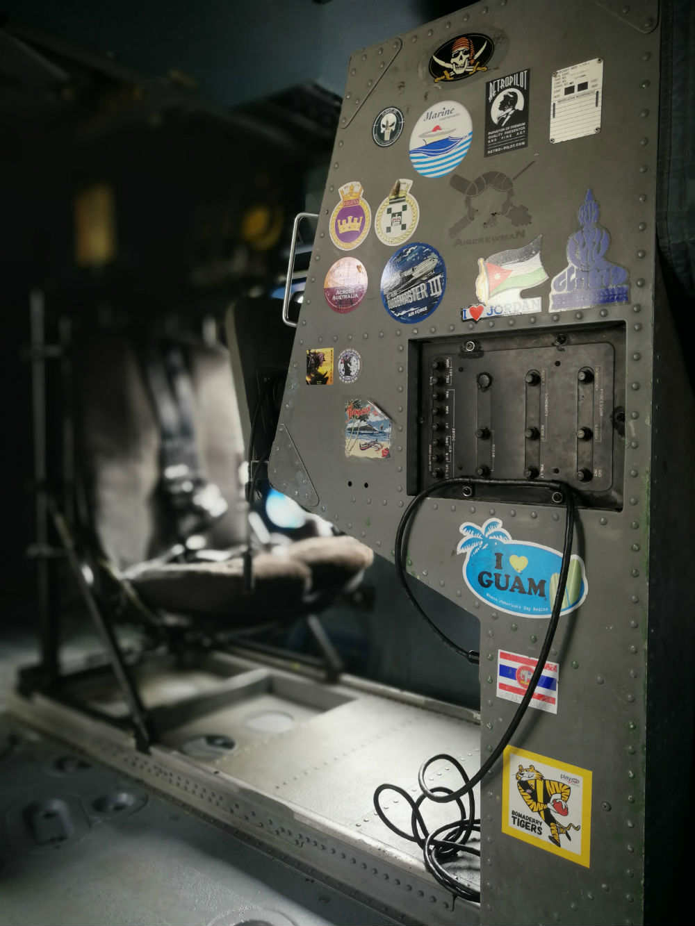Inside the Seahawk's electronic warfare station - decorated with tokens of places visited and people who served on it