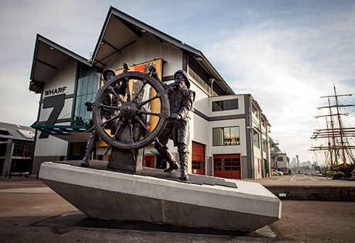 Photograph of the Windjammer Sailors sculpture outside the ANMM's Wharf 7 Heritage Centre