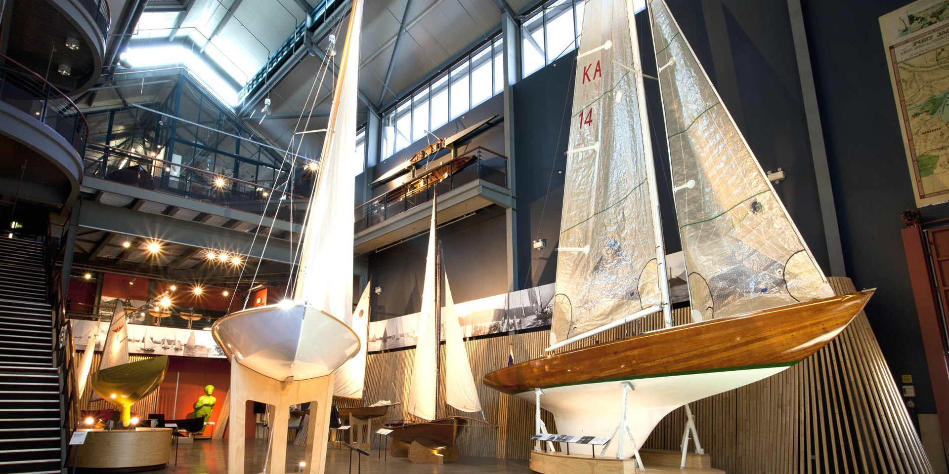 Interior views of the Wharf 7 building foyer. Pictured are various Sydney Heritage Fleet small boats.