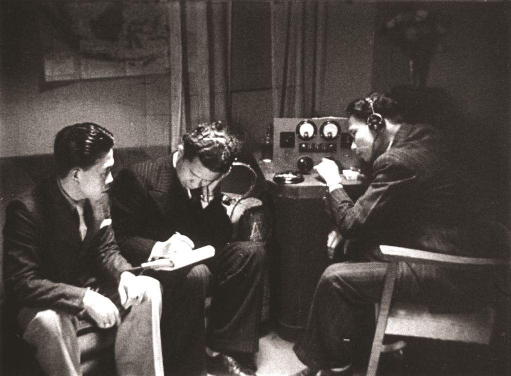 A scene from the 1946 Joris Ivens film Indonesia Calling  showing Indonesian seamen listening to a short-wave radio for news of Indonesia's declaration of independence.
